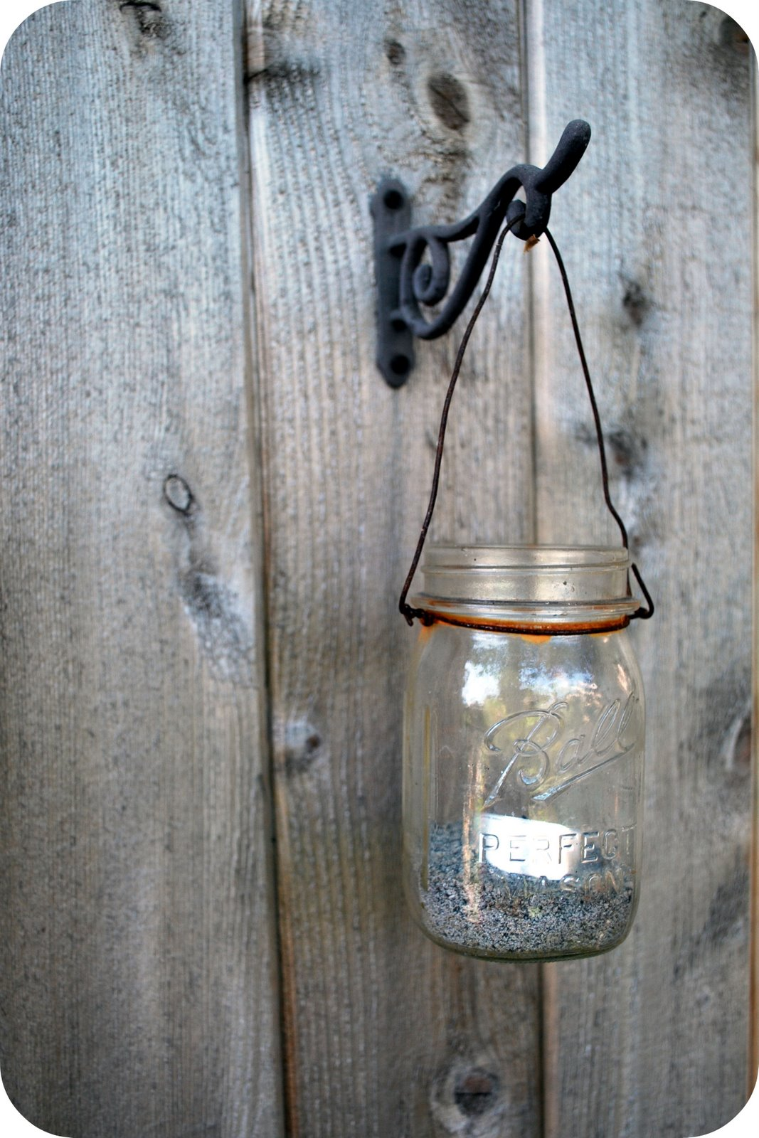 Diy mason jar outdoor lights allcrafts free crafts update for Hanging lights made from mason jars